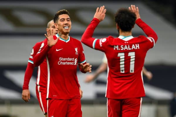 LONDON, ENGLAND - Thursday, January 28, 2021: Liverpool's Roberto Firmino (L) celebrates with team-mate Mohamed Salah (R) after scoring the first goal with the last kick of the first half during the FA Premier League match between Tottenham Hotspur FC and Liverpool FC at the Tottenham Hotspur Stadium. (Pic by Propaganda)