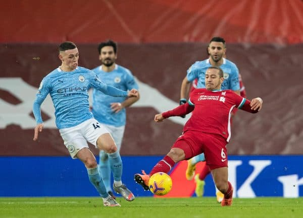 LIVERPOOL, ENGLAND - Sunday, February 7, 2021: Liverpool's Thiago Alcantara (R) and Manchester City's Phil Foden during the FA Premier League match between Liverpool FC and Manchester City FC at Anfield. (Pic by David Rawcliffe/Propaganda)
