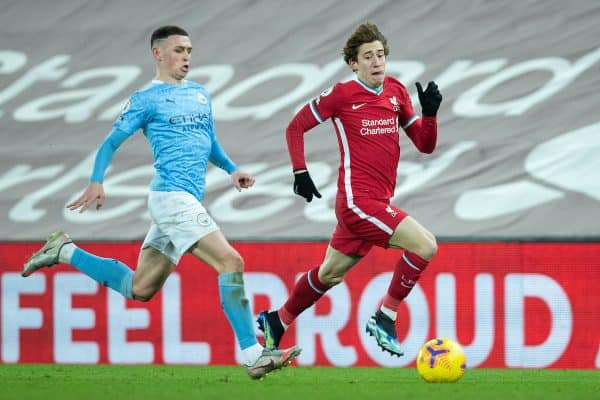 Liverpool's Kostas Tsimikas (R) and Manchester City's Phil Foden during the FA Premier League match between Liverpool FC and Manchester City FC at Anfield. (Pic by David Rawcliffe/Propaganda)