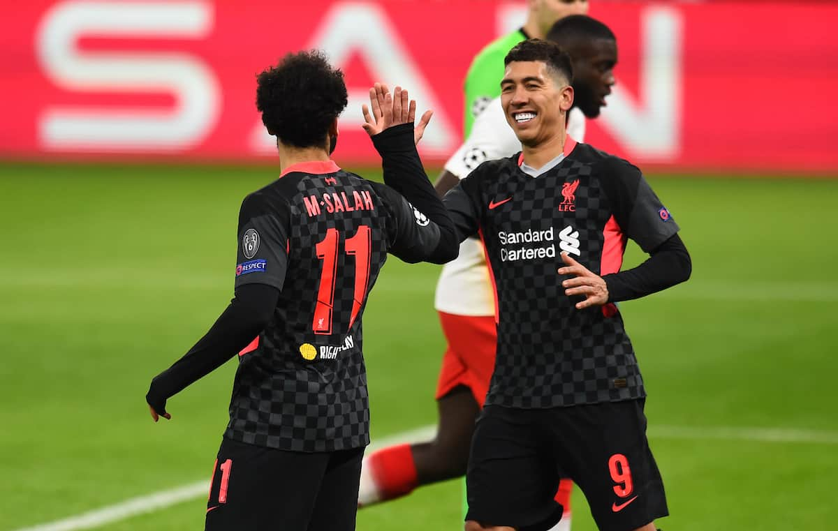 BUDAPEST, HUNGARY - Tuesday, February 16, 2021: Liverpool's Mohamed Salah (L) celebrates with team-mate Roberto Firmino after scoring the first goal during the UEFA Champions League Round of 16 1st Leg game between RB Leipzig and Liverpool FC at the Puskás Aréna. (Pic by Propaganda)