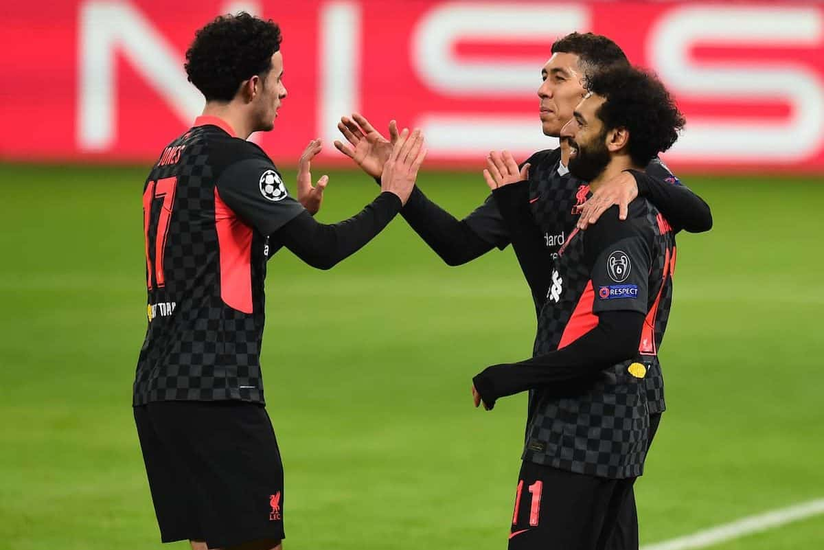 BUDAPEST, HUNGARY - Tuesday, February 16, 2021: Liverpool's Mohamed Salah (R) celebrates with team-mates Curtis Jones (L) and Roberto Firmino (C) after scoring the first goal during the UEFA Champions League Round of 16 1st Leg game between RB Leipzig and Liverpool FC at the Puskás Aréna. (Pic by Propaganda)
