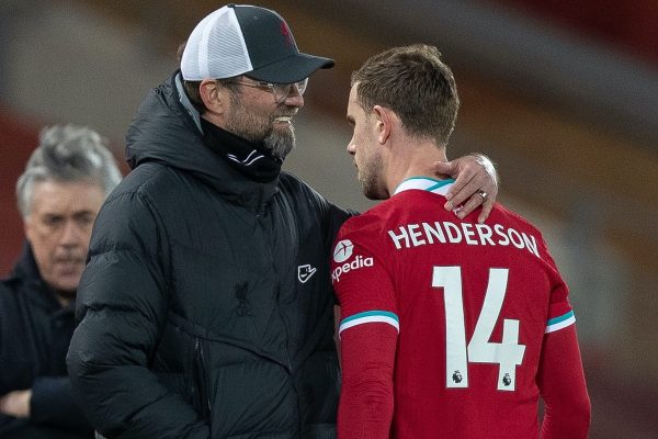 LIVERPOOL, ENGLAND - Saturday, February 20, 2021: Liverpool's captain Jordan Henderson walks past manager Jürgen Klopp injured during the FA Premier League match between Liverpool FC and Everton FC, the 238th Merseyside Derby, at Anfield. (Pic by David Rawcliffe/Propaganda)