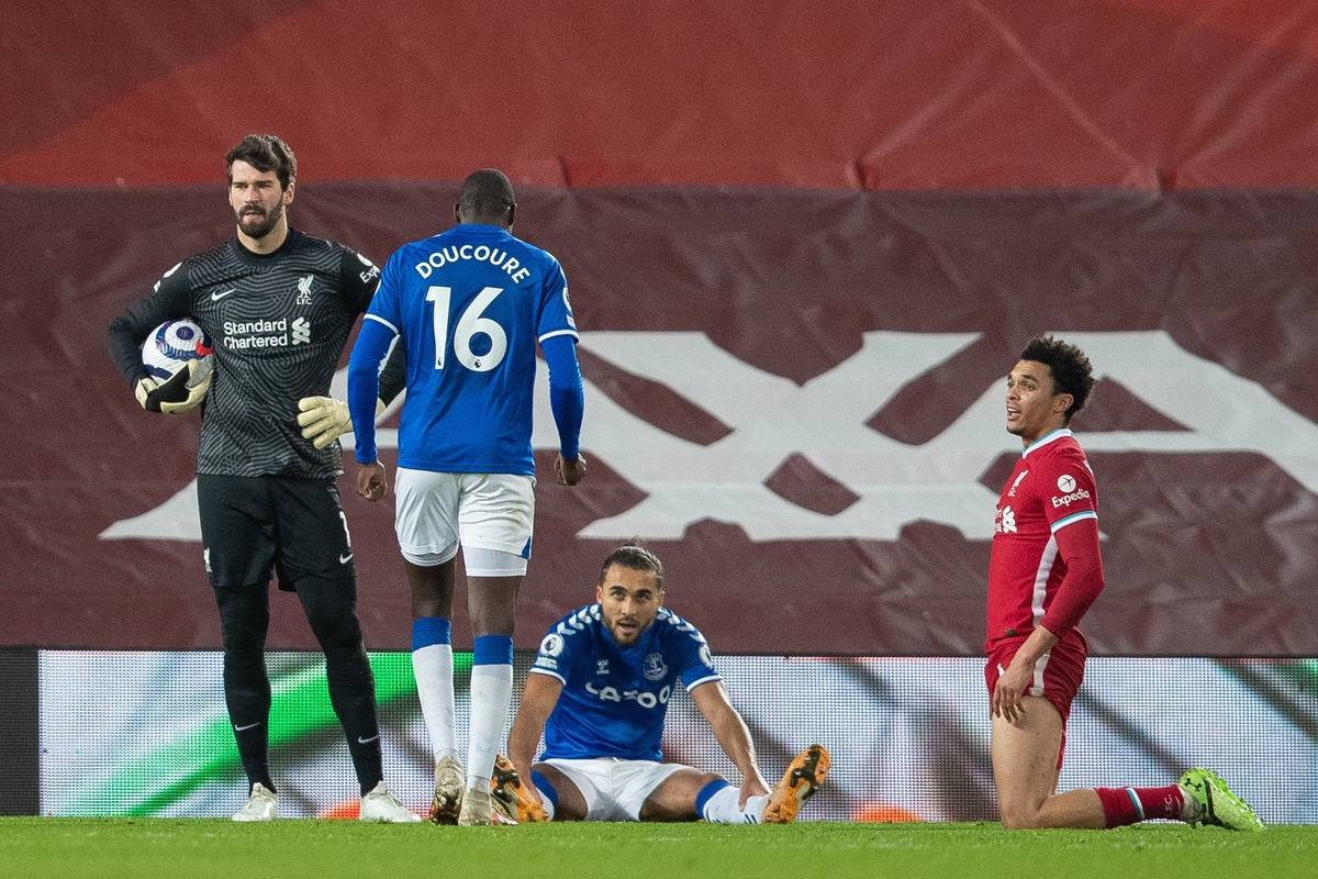 LIVERPOOL, ENGLAND - Saturday, February 20, 2021: Liverpool's goalkeeper Alisson Becker looks dejected as Everton's Dominic Calvert-Lewin wins a penalty during the FA Premier League match between Liverpool FC and Everton FC, the 238th Merseyside Derby, at Anfield. (Pic by David Rawcliffe/Propaganda)
