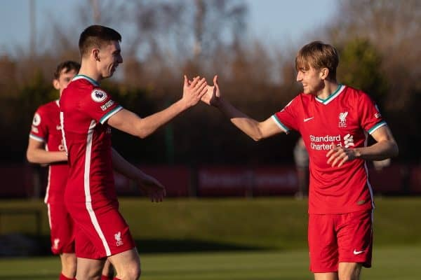 KIRKBY, ENGLAND - Saturday, February 27, 2021: Liverpool's Jake Cain (R) celebrates with team-mate captain Ben Woodburn (L) after scoring the third goal during the Premier League 2 Division 1 match between Liverpool FC Under-23's and Arsenal FC Under-23's at the Liverpool Academy. (Pic by David Rawcliffe/Propaganda)