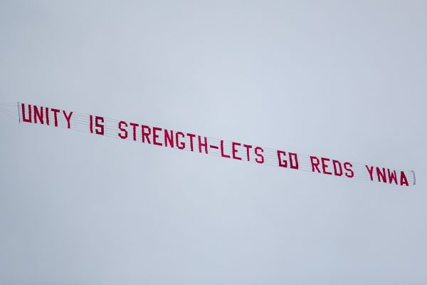 """LIVERPOOL, ENGLAND - Sunday, March 7, 2021: A plane banner flies over Anfield with the message """"Unityt is strength - Lets (sic) go Reds YNWA"""" during the FA Premier League match between Liverpool FC and Fulham FC at Anfield. (Pic by David Rawcliffe/Propaganda)"""