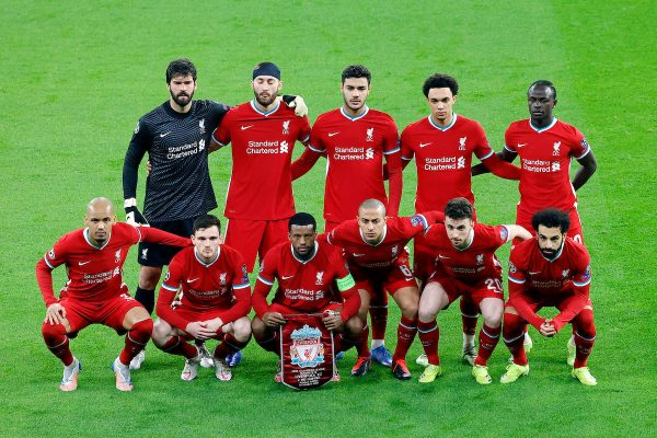 BUDAPEST, HUNGARY - Wednesday, March 10, 2021: Liverpool's players line-up for a team group photograph before the UEFA Champions League Round of 16 2nd Leg game between Liverpool FC and RB Leipzig at the Puskás Aréna. Back row L-R: goalkeeper Alisson Becker, Nathaniel Phillips, Ozan Kabak, Trent Alexander-Arnold, Sadio Mané. Front row L-R: Fabio Henrique Tavares 'Fabinho', Andy Robertson, Georginio Wijnaldum, Thiago Alcantara, Diogo Jota, Mohamed Salah. (Pic ©UEFA)