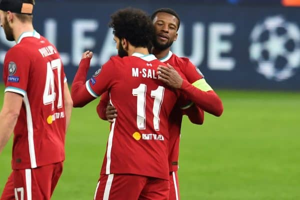 BUDAPEST, HUNGARY - Wednesday, March 10, 2021: Liverpool's Mohamed Salah (#11) celebrates with team-mate Georginio Wijnaldum after scoring the first goal during the UEFA Champions League Round of 16 2nd Leg game between Liverpool FC and RB Leipzig at the Puskás Aréna. (Pic by Propaganda)