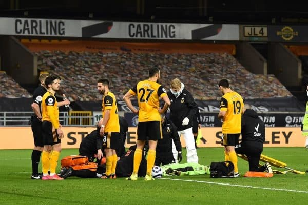 WOLVERHAMPTON, ENGLAND - Monday, March 15, 2021: Wolverhampton Wanderers' goalkeeper Rui Patricio receives treatment for a head injury during the FA Premier League match between Wolverhampton Wanderers FC and Liverpool FC at Molineux Stadium. (Pic by Propaganda)