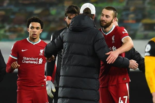 WOLVERHAMPTON, ENGLAND - Monday, March 15, 2021: Liverpool's Nathaniel Phillips embraces manager Jürgen Klopp after the FA Premier League match between Wolverhampton Wanderers FC and Liverpool FC at Molineux Stadium. (Pic by Propaganda)