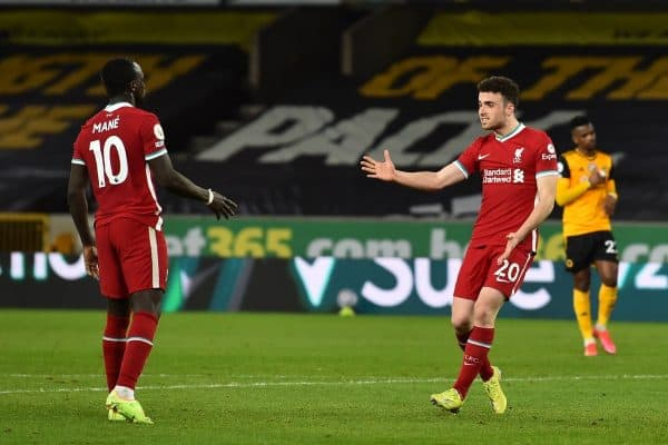 WOLVERHAMPTON, ENGLAND - Monday, March 15, 2021: Liverpool's Diogo Jota (R) celebrates with team-mate Sadio Mané after scoring the first goal during the FA Premier League match between Wolverhampton Wanderers FC and Liverpool FC at Molineux Stadium. (Pic by Propaganda)