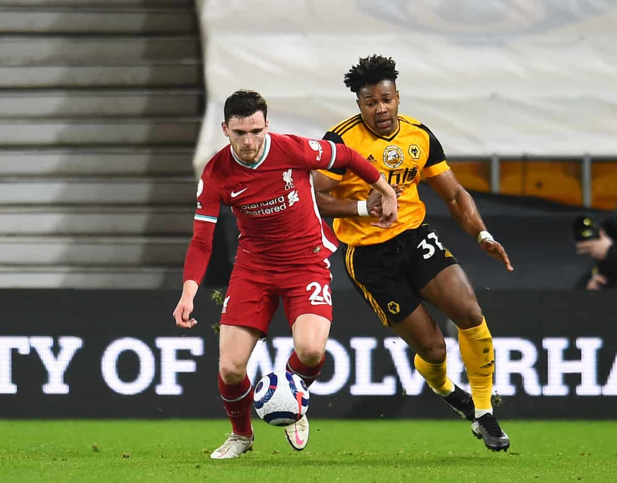 WOLVERHAMPTON, ENGLAND - Monday, March 15, 2021: Liverpool's Andy Robertson (L) and Wolverhampton Wanderers' Adama Traoré during the FA Premier League match between Wolverhampton Wanderers FC and Liverpool FC at Molineux Stadium. (Pic by Propaganda)