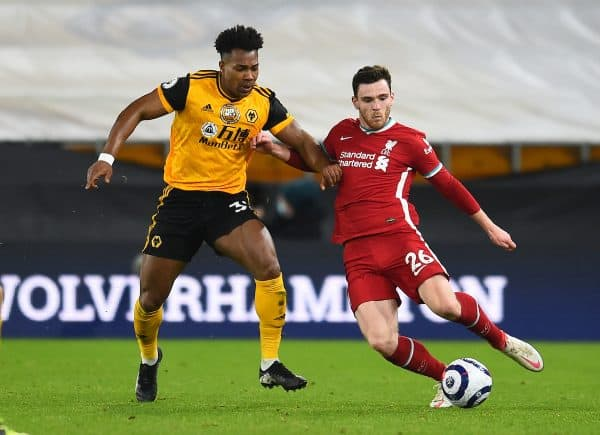 WOLVERHAMPTON, ENGLAND - Monday, March 15, 2021: Liverpool's Andy Robertson (R) and Wolverhampton Wanderers' Adama Traoré during the FA Premier League match between Wolverhampton Wanderers FC and Liverpool FC at Molineux Stadium. (Pic by Propaganda)