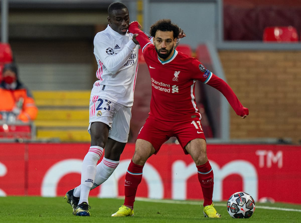 LIVERPOOL, ENGLAND - Wednesday, April 14, 2021: Liverpool's Mohamed Salah (R) and Real Madrid's Ferland Mendy during the UEFA Champions League Quarter-Final 2nd Leg game between Liverpool FC and Real Madird CF at Anfield. (Pic by David Rawcliffe/Propaganda)