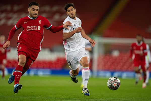 LIVERPOOL, ENGLAND - Wednesday, April 14, 2021: Liverpool's Ozan Kabak (L) challenges Real Madrid's Marco Asensio during the UEFA Champions League Quarter-Final 2nd Leg game between Liverpool FC and Real Madird CF at Anfield. (Pic by David Rawcliffe/Propaganda)