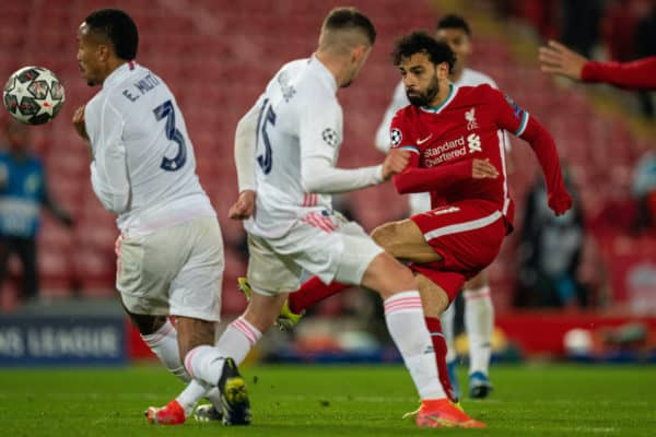 LIVERPOOL, ENGLAND - Wednesday, April 14, 2021: Liverpool's Mohamed Salah shoots during the UEFA Champions League Quarter-Final 2nd Leg game between Liverpool FC and Real Madird CF at Anfield. (Pic by David Rawcliffe/Propaganda)