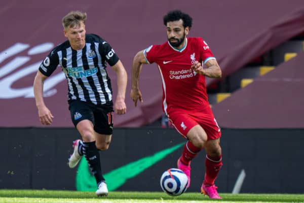 LIVERPOOL, ENGLAND - Saturday, April 24, 2021: Liverpool's Mohamed Salah (R) and Newcastle United's Matt Ritchie during the FA Premier League match between Liverpool FC and Newcastle United FC at Anfield. (Pic by David Rawcliffe/Propaganda)