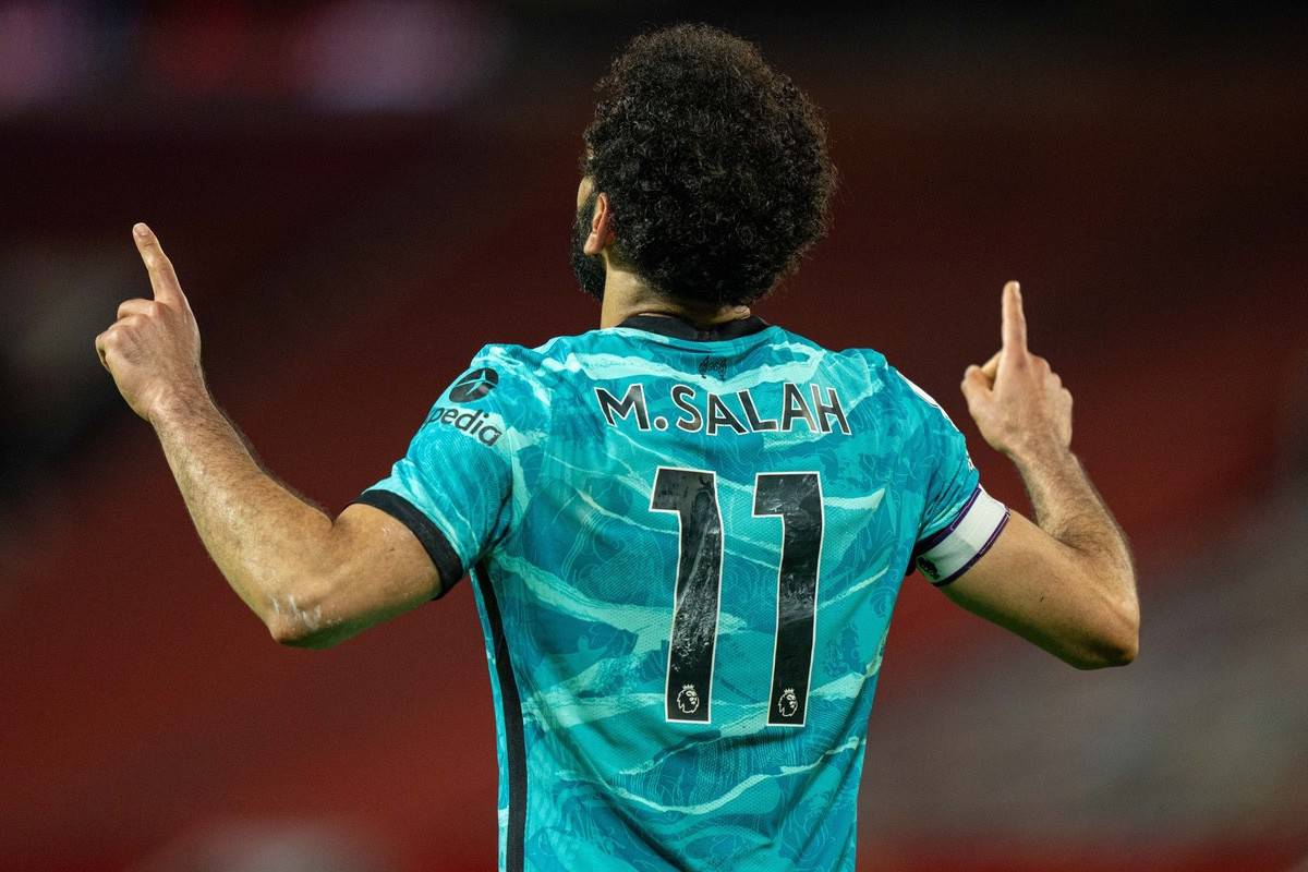 MANCHESTER, ENGLAND - Thursday, May 13, 2021: Liverpool's Mohamed Salah kneels celebrates after scoring the fourth goal during the FA Premier League match between Manchester United FC and Liverpool FC at Old Trafford. (Pic by David Rawcliffe/Propaganda)