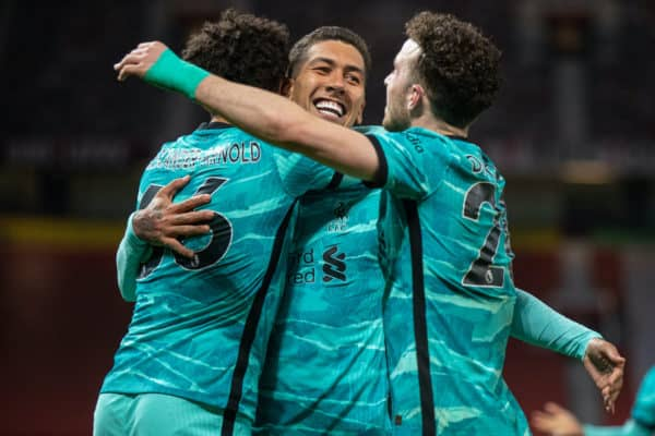 MANCHESTER, ENGLAND - Thursday, May 13, 2021: Liverpool's Roberto Firmino (C) celebrates with team-mates Mohamed Salah (L) and Diogo Jota (R) after scoring the third goal, his second of the game, during the FA Premier League match between Manchester United FC and Liverpool FC at Old Trafford. (Pic by David Rawcliffe/Propaganda)