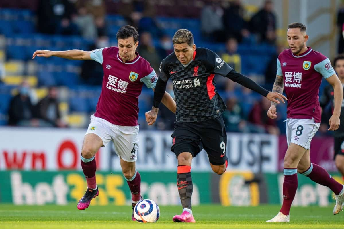 BURNLEY, ENGLAND - Wednesday, May 19, 2021: Liverpool's Roberto Firmino (R) is challenged by Burnley's Jack Cork (L) during the FA Premier League match between Burnley FC and Liverpool FC at Turf Moor. (Pic by David Rawcliffe/Propaganda)