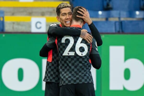 BURNLEY, ENGLAND - Wednesday, May 19, 2021: Liverpool's Roberto Firmino (L) celebrates with team-mate Andy Robertson after scoring the first goal during the FA Premier League match between Burnley FC and Liverpool FC at Turf Moor. (Pic by David Rawcliffe/Propaganda)