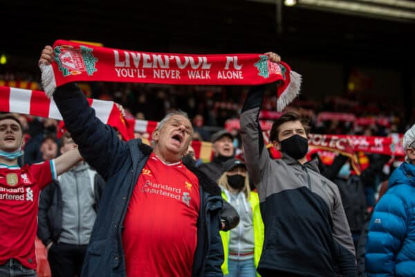 """LIVERPOOL, ENGLAND - Sunday, May 23, 2021: Liverpool supporters sing """"You'll Never Walk Alone"""" before the final FA Premier League match between Liverpool FC and Crystal Palace FC at Anfield. (Pic by David Rawcliffe/Propaganda)"""