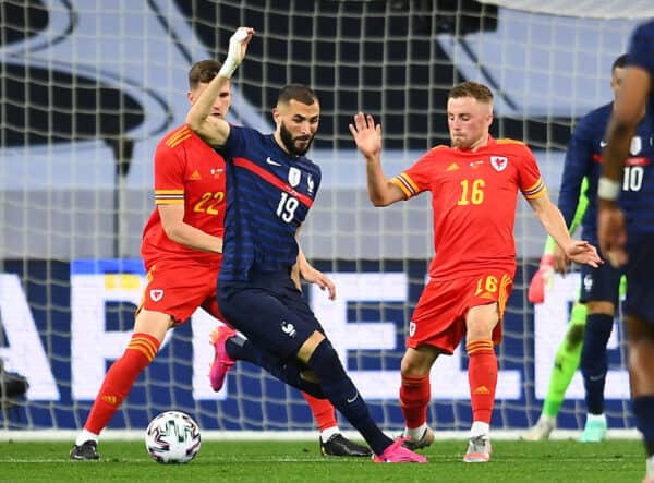 NICE, FRANCE - Wednesday, June 2, 2021: France's Karim Benzema (L) and Wales' Joseff Morrell during an international friendly match between France and Wales at the Stade Allianz Riviera ahead of the UEFA Euro 2020 tournament. (Pic by Simone Arveda/Propaganda)
