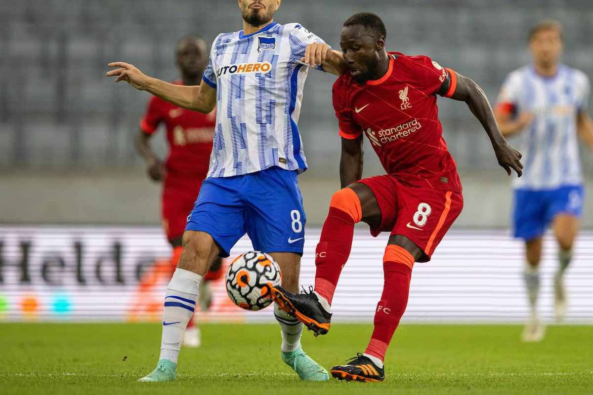 INNSBRUCK, AUSTRIA - Thursday, July 29, 2021: Liverpool's Naby Keita (R) is tackled by Hertha BSC's Suat Serdar during a pre-season friendly match between Liverpool FC and Hertha BSC at the Tivoli Stadion. (Pic by Jürgen Faichter/Propaganda)