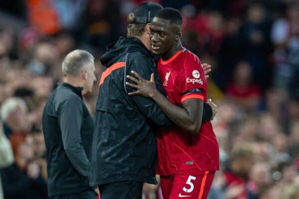 LIVERPOOL, ENGLAND - Monday, August 9, 2021: Liverpool's manager Jürgen Klopp embraces Ibrahima Konaté during a pre-season friendly match between Liverpool FC and Club Atlético Osasuna at Anfield. (Pic by David Rawcliffe/Propaganda)