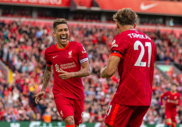 LIVERPOOL, ENGLAND - Monday, August 9, 2021: Liverpool's Roberto Firmino (L) celebrates with team-mate Kostas Tsimikas after scoring the second goal during a pre-season friendly match between Liverpool FC and Club Atlético Osasuna at Anfield. (Pic by David Rawcliffe/Propaganda)