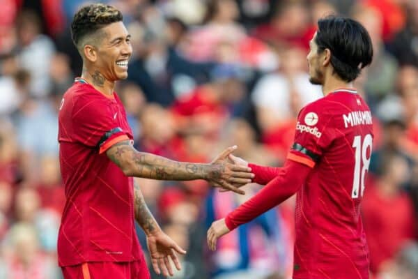 Liverpool's Roberto Firmino (L) celebrates after scoring the third goal, his second, with team-mate Takumi Minamino during a pre-season friendly match between Liverpool FC and Club Atlético Osasuna at Anfield. (Pic by David Rawcliffe/Propaganda)