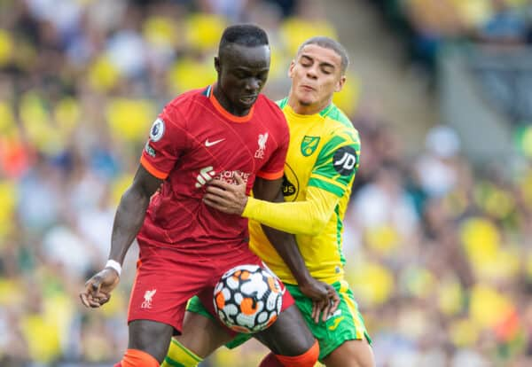 NORWICH, ENGLAND - Saturday August 14, 2021: Sadio Mane (L) of Liverpool and Max Aarons of Norwich City during the FA Premier League match between Norwich City FC and Liverpool FC at Carrow Road.  (Photo by David Rawcliffe / Propaganda)