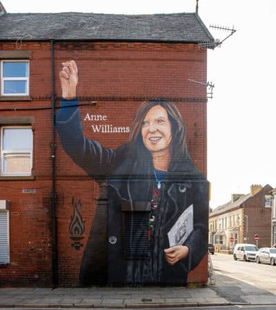 LIVERPOOL, ENGLAND - Friday, August 20, 2021: A street art mural of Hillsbrough justice campaigner Anne Williams, painted on the side of a building in Anfield only a few streets away from Liverpool Football Club's Anfield stadium. (Pic by David Rawcliffe/Propaganda)