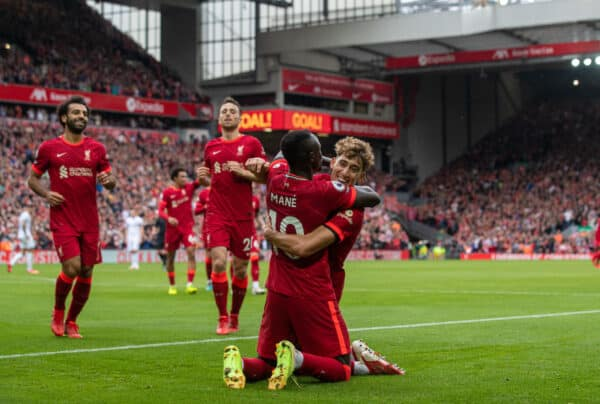 Liverpool's Sadio Mané (#10) celebrates with team-mates Mohamed Salah (L), Diogo Jota (C) and Kostas Tsimikas (R) after scoring the second goal during the FA Premier League match between Liverpool FC and Burnley FC at Anfield. (Pic by David Rawcliffe/Propaganda)