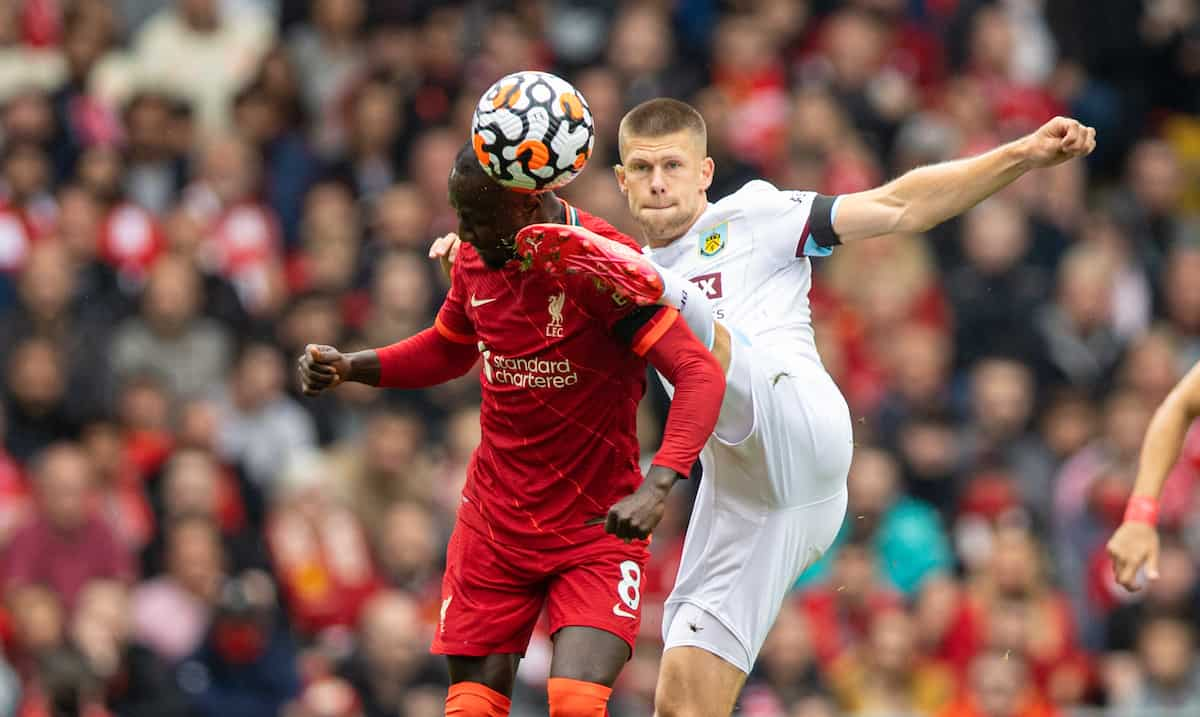 LIVERPOOL, ENGLAND - Saturday, August 21, 2021: Liverpool's Naby Keita is kicked in the head by Burnley's Josh Brownhill during the FA Premier League match between Liverpool FC and Burnley FC at Anfield. (Pic by David Rawcliffe/Propaganda)