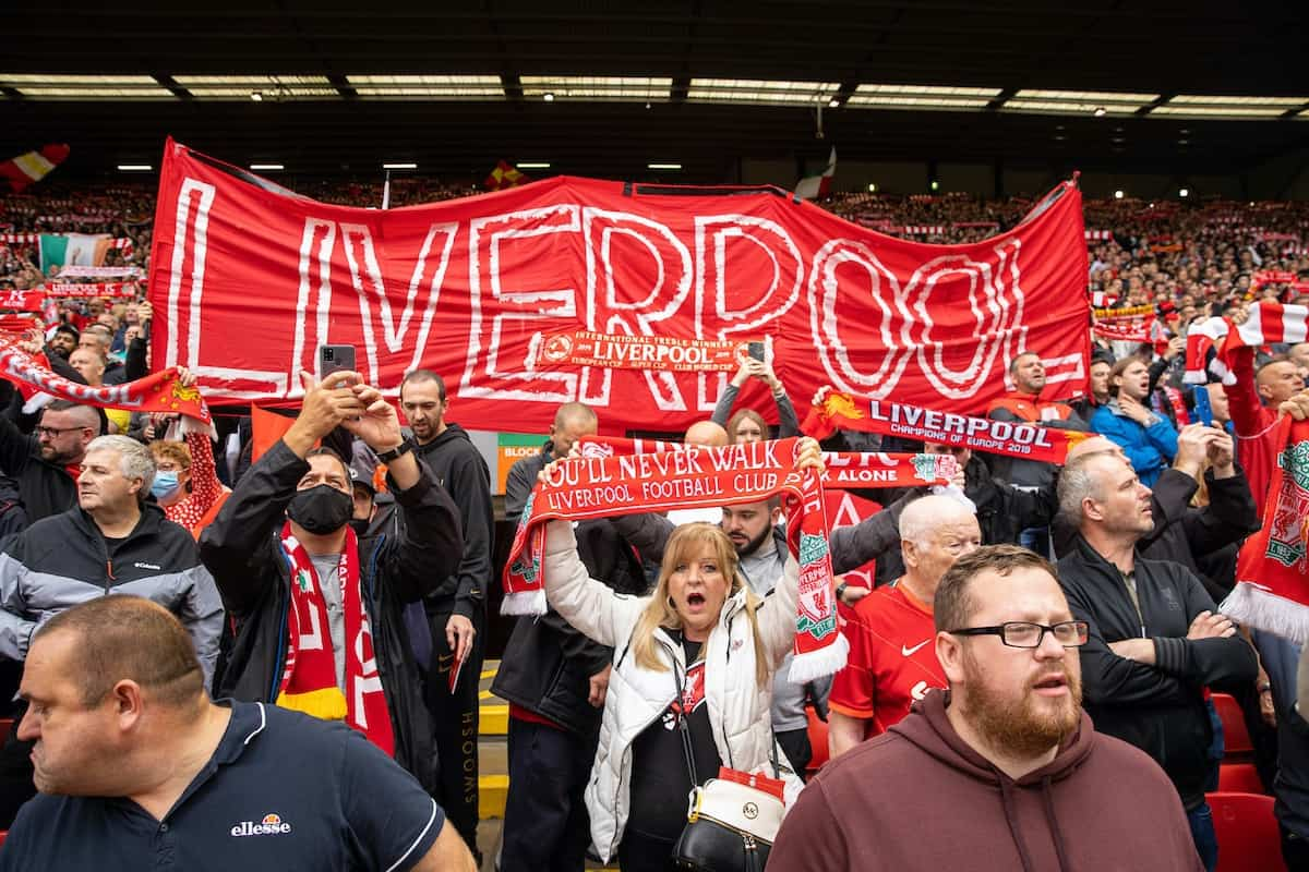 """LIVERPOOL, ENGLAND - Saturday, August 21, 2021: Liverpool supporters sing """"You'll Never Walk Alone"""" before the FA Premier League match between Liverpool FC and Burnley FC at Anfield. (Pic by David Rawcliffe/Propaganda)"""