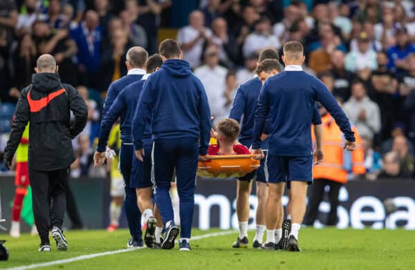 Liverpool's Harvey Elliott is carried off injured during the FA Premier League match between Leeds United FC and Liverpool FC at Elland Road. (Pic by David Rawcliffe/Propaganda)