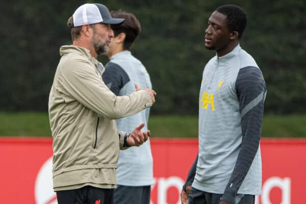 LIVERPOOL, ENGLAND - Tuesday, September 14, 2021: Liverpool's manager Jürgen Klopp (L) chats with Ibrahima Konaté during a training session at the AXA Training Centre ahead of the UEFA Champions League Group B Matchday 1 game between Liverpool FC and AC MIlan. (Pic by David Rawcliffe/Propaganda)