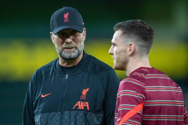 NORWICH, ENGLAND - Tuesday, September 21, 2021: Liverpool's manager Jürgen Klopp chats with Andy Robertson (R) during the pre-match warm-up before the Football League Cup 3rd Round match between Norwich City FC and Liverpool FC at Carrow Road. (Pic by David Rawcliffe/Propaganda)
