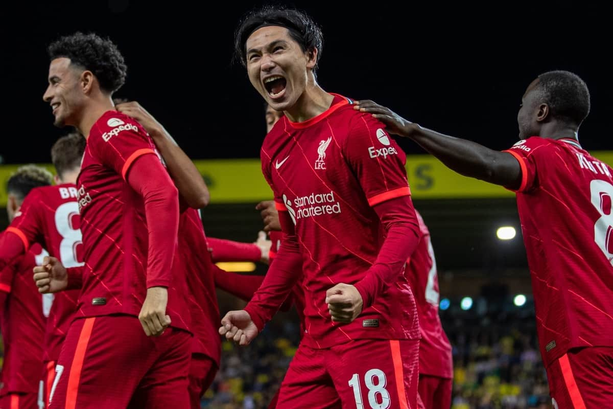 NORWICH, ENGLAND - Tuesday, September 21, 2021: Liverpool's Takumi Minamino (C) celebrates with team-mates after scoring the first goal during the Football League Cup 3rd Round match between Norwich City FC and Liverpool FC at Carrow Road. (Pic by David Rawcliffe/Propaganda)