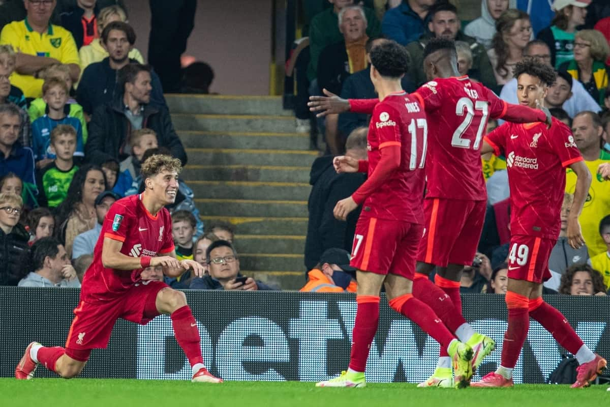 NORWICH, ENGLAND - Tuesday, September 21, 2021: Liverpool's Kostas Tsimikas (L) celebrates wuth goal-scorer Divock Origi (#27) after the second goal during the Football League Cup 3rd Round match between Norwich City FC and Liverpool FC at Carrow Road. (Pic by David Rawcliffe/Propaganda)