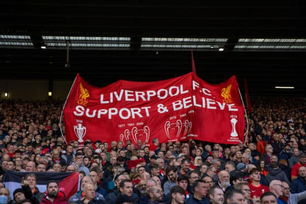 """LIVERPOOL, ENGLAND - Sunday, October 3, 2021: Liverpool supporters' banner """"Support & Believe"""" on the Spion Kop before the FA Premier League match between Liverpool FC and Manchester City FC at Anfield. (Pic by David Rawcliffe/Propaganda)"""