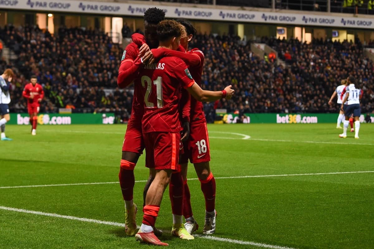 PRESTON, ENGLAND - Wednesday, October 27, 2021: Liverpool's Divock Origi (L) celebrates with team-mates Kostas Tsimikas (C) and Takumi Minamino (R) after scoring the second goal during the English Football League Cup 4th Round match between Preston North End FC and Liverpool FC at Deepdale. Liverpool won 2-0. (Pic by David Rawcliffe/Propaganda)