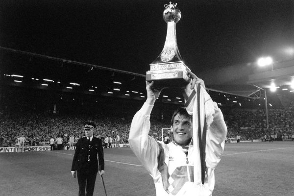 Liverpool player/manager Kenny Dalglish holds up one of the two league championship trophies for the fans at Anfield, after helping his side to beat Derby County 1-0. Dalglish came on as a substitute after 71 minutes; 10 minutes later Gary Gillespie scored the only goal.