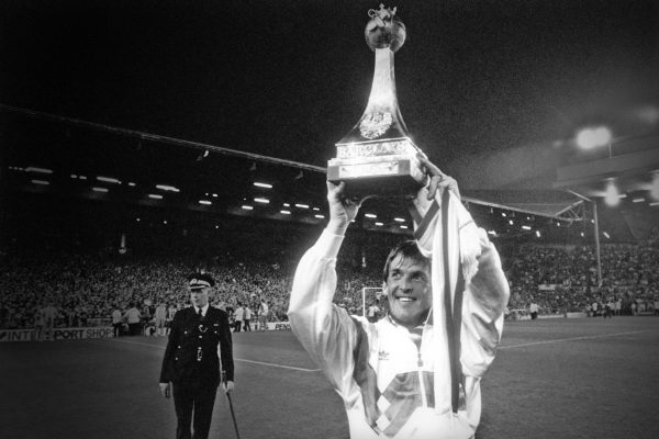 Kenny Dalglish with the league title trophy, 1990 (PA Images)