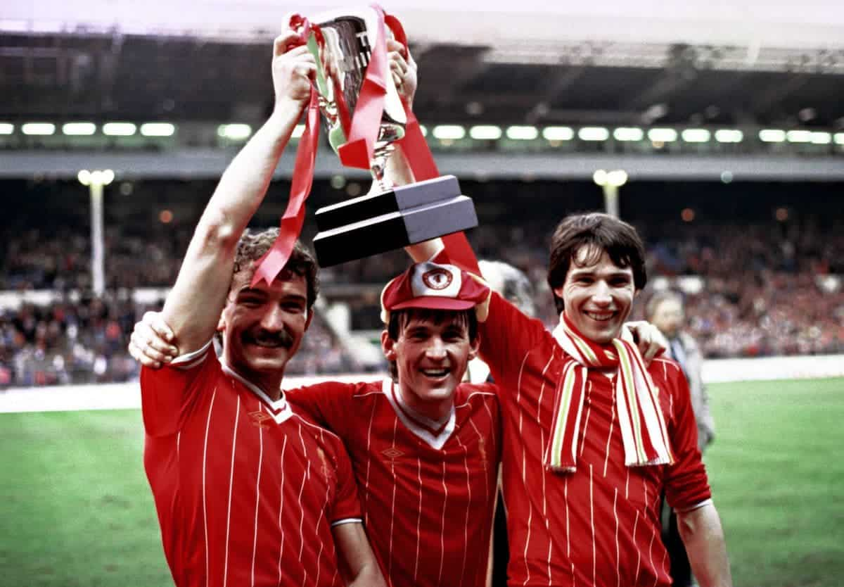 Delighted Liverpool players (from left) Graham Souness, Kenny Dalglish and Alan Hansen celebrate with the Milk Cup trophy after they defeated Manchester United 2-1 in extra time at Wembley. It was Liverpool's third successive triumph in the competition, giving manager Bob Paisley a winning farewell to Wembley etires at the end of the season.