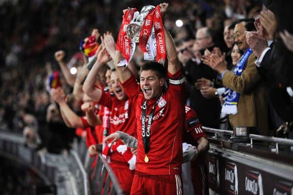 Liverpool's Steven Gerrard celebrates with the Carling Cup Trophy