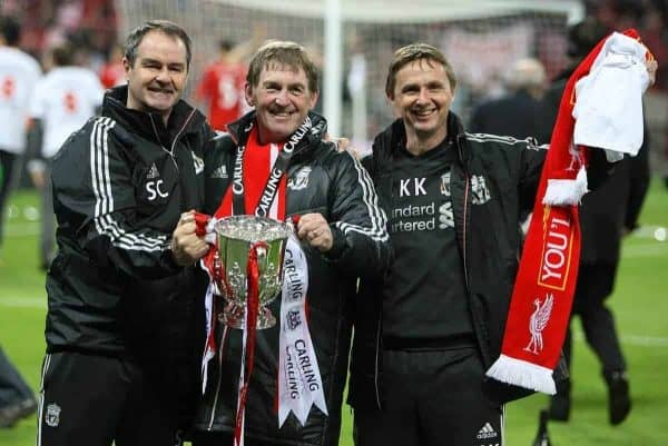 Liverpool's manager Kenny Dalglish (centre), First-team Coaches Steve Clarke (left) and Kevin Keen (right) with the Carling Cup trophy