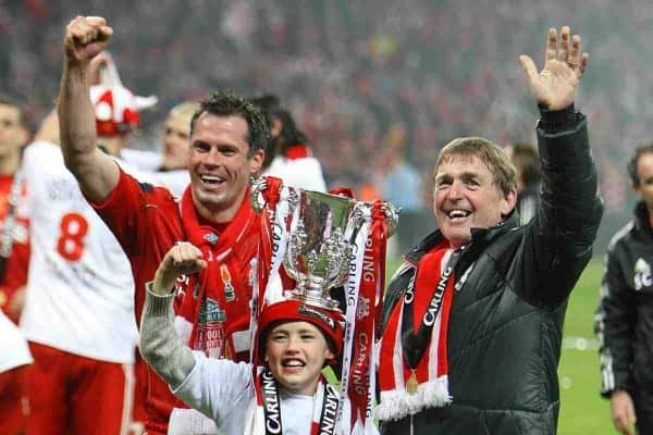 Liverpool's manager Kenny Dalglish (right) and Jamie Carragher (left) celebrate after the game