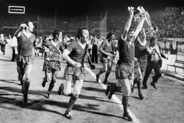 Liverpool captain Emlyn Hughes holds aloft the European Cup along with his victorius teammates after the English club beat German side Borussia Moenchengladbach in the final held in Rome, Italy.