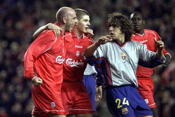 Liverpool's Gary McAllister (left) celebrates his goal scored from the penalty spot with team mate Steven Gerrard as Barcelona's Carles Puyol (right) looks on during the UEFA Cup semi-final second leg match at Anfield, Liverpool.